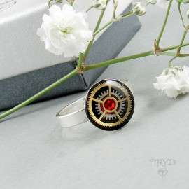 Sterling silver ring with red zircon and watch gears