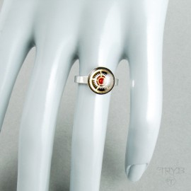 Steampunk silver ring with watch gears and red zircon
