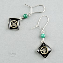 Long earrings of silver with geometric motifs made of watch parts.