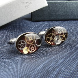 Burgundy cufflinks from silver and watch cogs.
