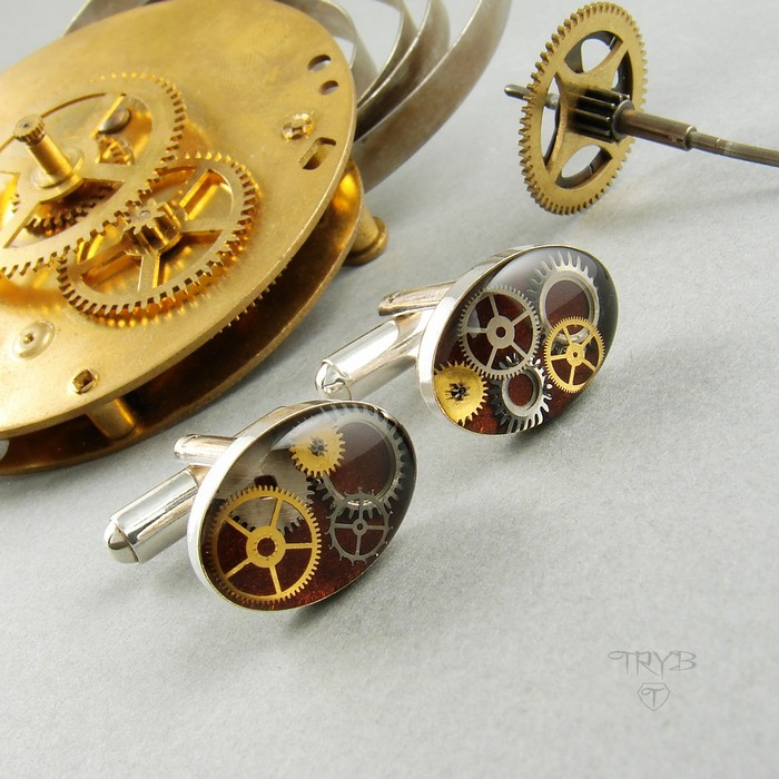 Sterling silver cufflinks with real watch cogs at burgundy background