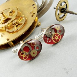 Small, oval, sterling silver cufflinks with cogs in red