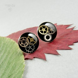 Round, black ear studs with...