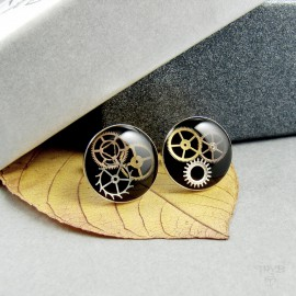 Round, black ear studs with cogs