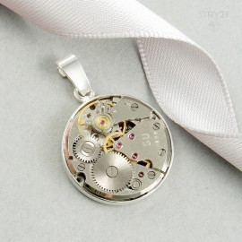 Round, sterling silver pendant with watch movement