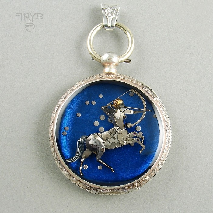 Outstanding Sagittarius pendant of silver and watch parts