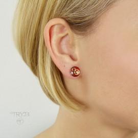 Red stud earrings with watch gears