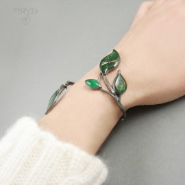 Twig shaped bracelet with leaves and clockwork dragonflies