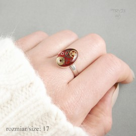 red, oval ring of silver