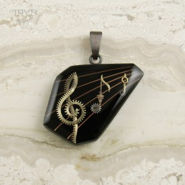 Hand crafted music pendant with treble clef and notes from silver and watch parts