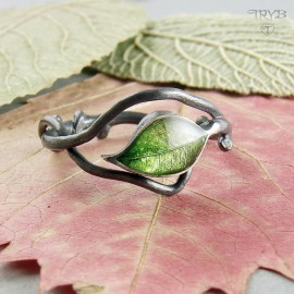 Hand crafted sterling silver ring with a leaf on a twig
