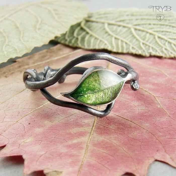 Oxidized silver ring leaf on a twig