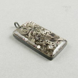 Men's pendant of silver and watch movements parts