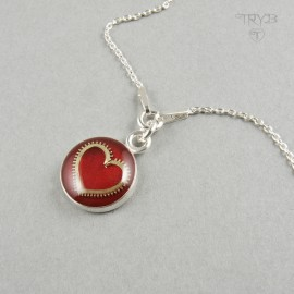 Sterling silver necklace with heart of a watch gear