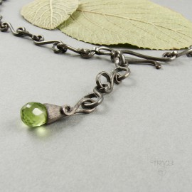 Natural peridots in oxidized silver