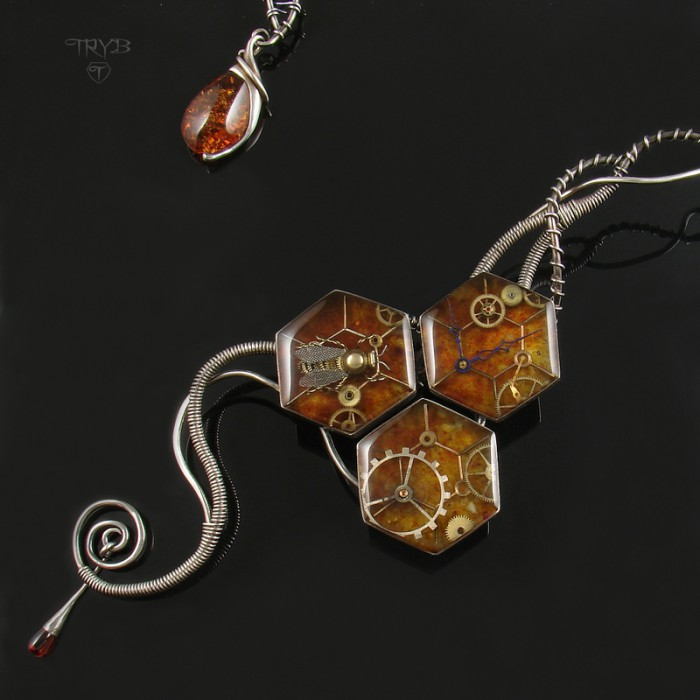 Wire wrapped asymmetrical necklace with bee