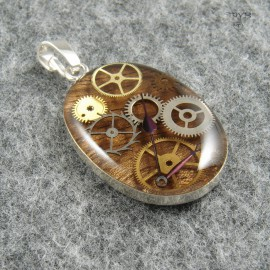 Oval pendant of wood, silver and gears