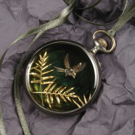 Tropical bird and leaves pendant