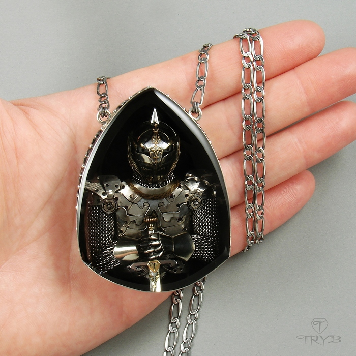 Sterling silver necklace with knight sculpture of watch parts