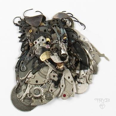 Miniaturowa rzeźba psa owczarka szetlandzkiego z części zegarków