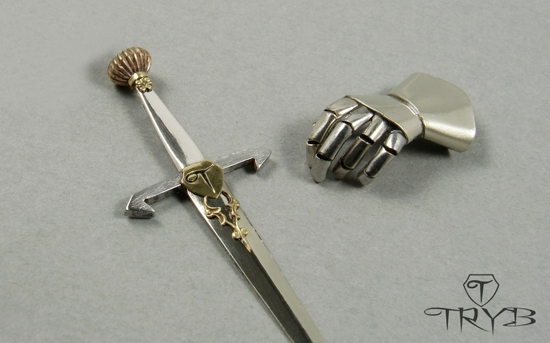 Miniature knight glove and sword sculpture of watch parts